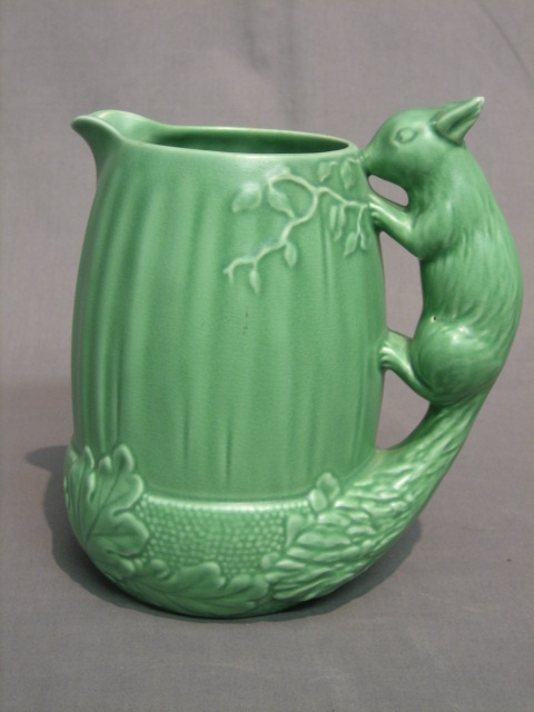 Lot No 675 A Green Glazed Sylvac Jug The Handle In The Form Of A Squirrel The Base Impressed