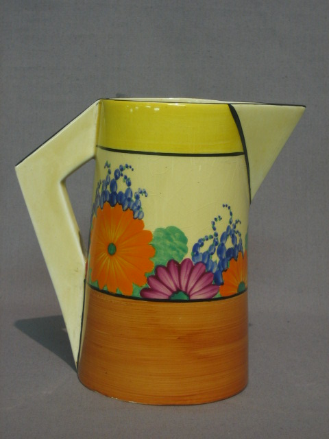 A Clarice Cliff Gay Day pattern jug, the base with rubber stamp mark 6 1/2