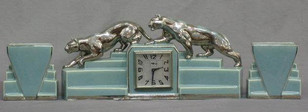 An Art Deco Turquoise Pottery 3 Piece Clock Garniture 16th April 2008 Denhams