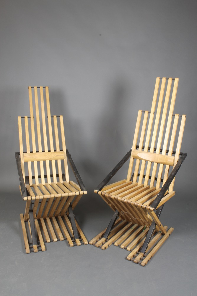 jim warren a pair of stylish metal and slatted folding teak chairs