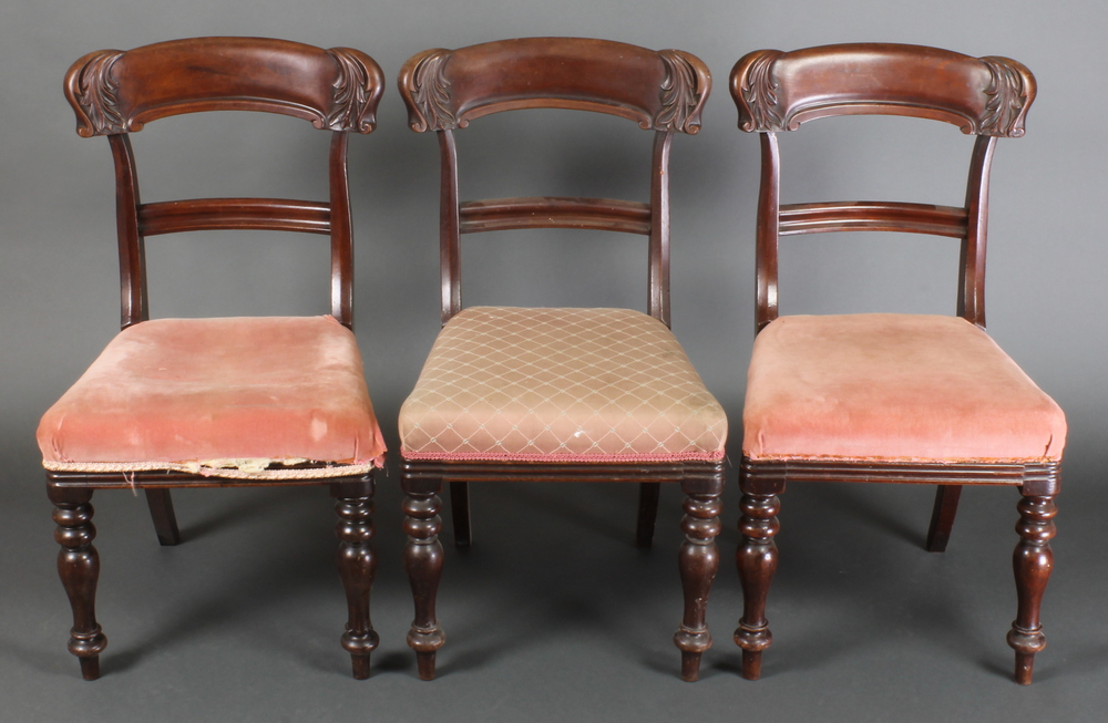 A set of regency mahogany carved bar back dining th