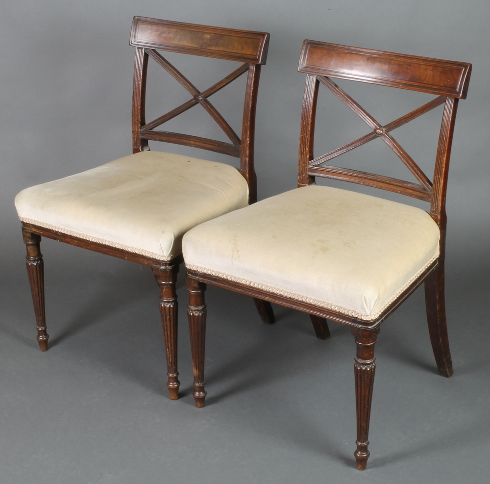A pair of th century mahogany bar back dining chairs